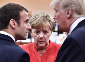 Emmanuel Macron (l-r), Angela Merkel und Donald Trump unterhalten sich beim G20-Gipfel. Foto: John Macdougall/DPA