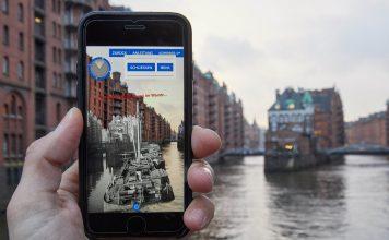 Ein Iphone 7 mit der geöffneten App «Speicherstadt digital. Foto: Georg Wendt/dpa