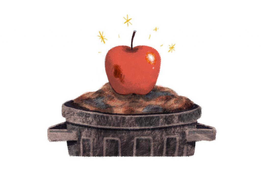 Ein Apfel mit wenigen Druckstellen liegt im Mülleimer.