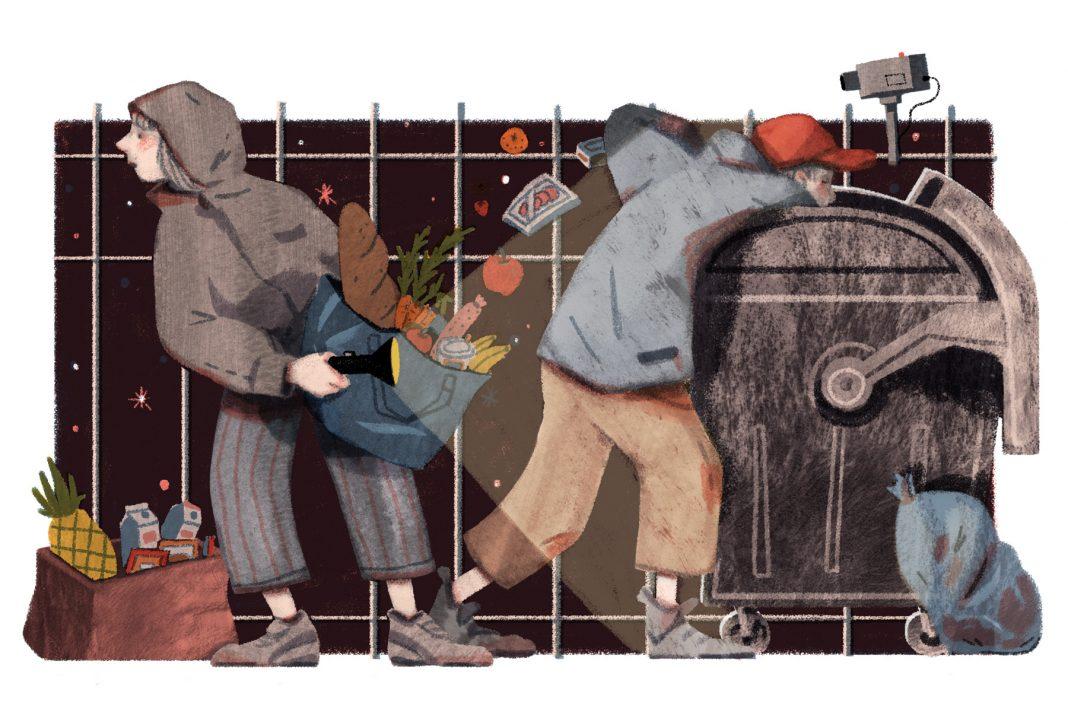 Zwei Personen sammeln in der Dunkelheit Lebensmittel aus einem Container.