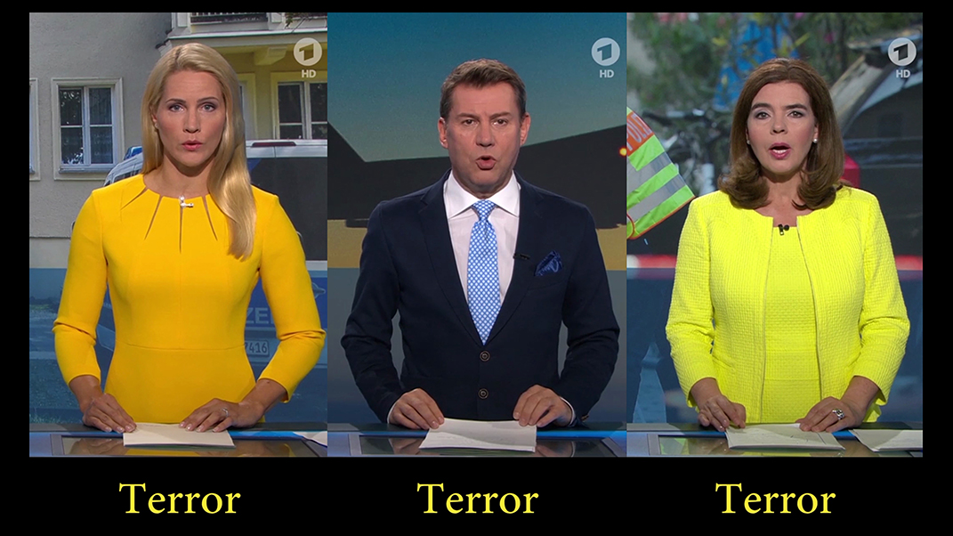 """Nachrichtensprecher mit Bauchbinde """"Terror""""."""