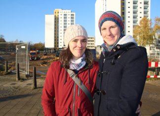 Luc Anna und Birte Mühlbach stehen vor der großen Baustelle in Mümmelmannsberg. Hier entsteht unter anderem ein großer Supermarkt.