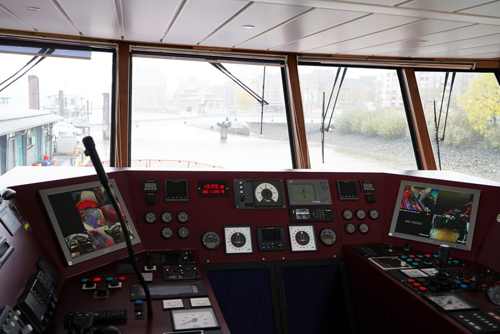There are a lot buttons and screens in the wheelhouse of a ferry.