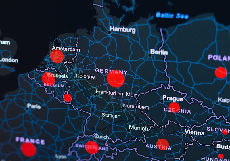 Eine Europakarte mit roten Kreisen, die für die Ausbreitung des Coronavirus stehen