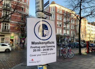 Änderung der Maskenpflicht: Hinweisschild am Schulterblatt in Hamburg.